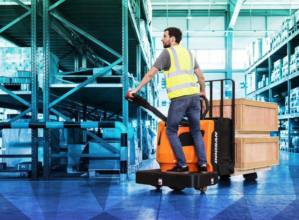 warehouse operator moving load