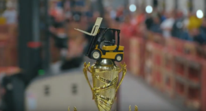 Forklift rodeo trophy displayed in the image.